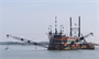 Wachapreague, Va -- The dredge Richmond works off the coast of Virginia. The U.S. Army Corps of Engineers is overseeing the contract awarded to Cottrell Contracting Corporation