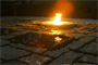 ARLINGTON, Va –The President John F. Kennedy Eternal Flame at Arlington National Cemetery  burns brightly before contractors install white fencing to block the public's view of the site April 29, 2013.  Repairs and upgrades to the flame include installing burners, an igniter, and new gas and air lines. Contractors estimate that work on the burner itself  will take three weeks. (U.S. Army photo/Patrick Bloodgood)
